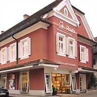 Logo 60) Buchhandlung Plautz