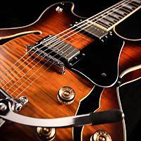 Logo 2) Guitars On Main